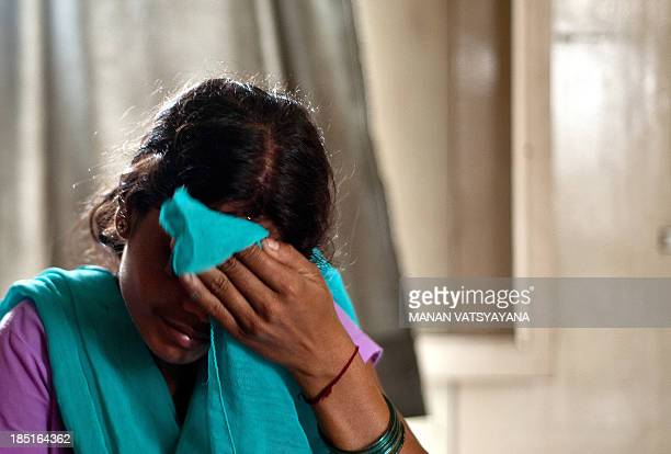 IndiacrimesocialtraffickingchildrenFEATURE by Trudy Harris In this photograph taken on September 16 an alleged Indian humantrafficking victim sits at...