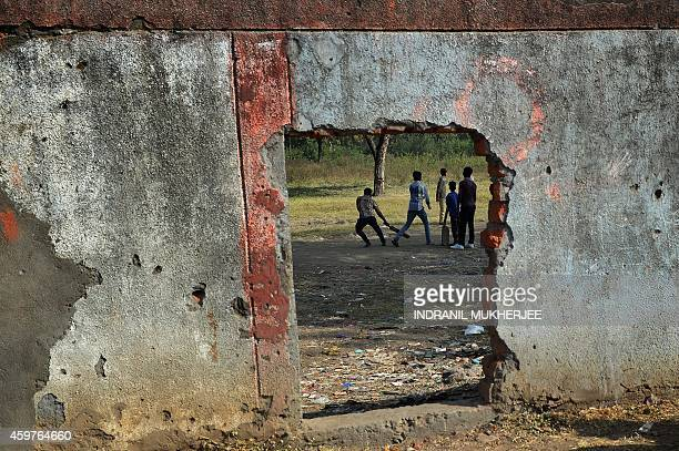 IndiadisasterpollutionBhopalanniversarychildrenFOCUS Indian children play cricket inside the Union Carbide factory grounds in Bhopal on November 29...