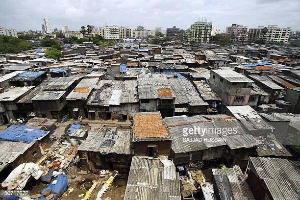 India-economy-slum-housing-social' by Penny MACRAE File picture taken on June 17, 2007 shows office blocks and residential buildings towering above...