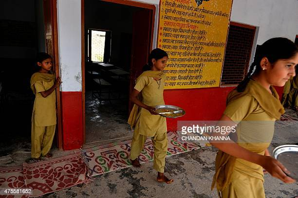 IndiaeducationschoolhealthfoodFEATURE by Abhaya SRIVASTAVA In this photo taken on May 19 Indian schoolgirls bring their plates to be cleaned after...