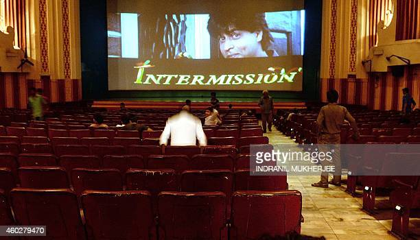 India-entertainment-Bollywood-cinema,FOCUS by Aditya PHATAK In this photograph taken on December 5 Indian cinemagoers leave their seats as an...