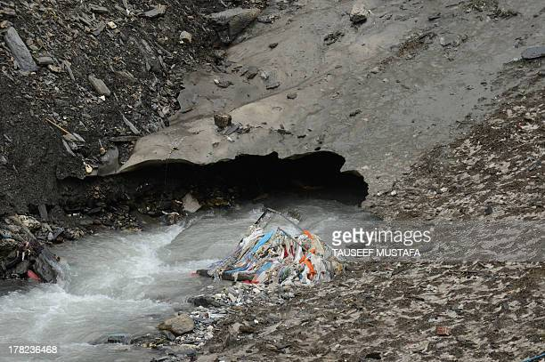 IndiaenvironmentpollutionpilgrimagesFEATURE by Parvaiz Bukhari Accumulated rubbish lies in a stream of glacial meltwaters along the track to the...