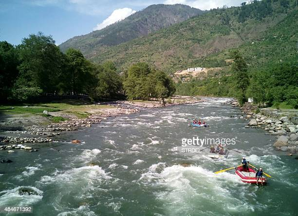 IndiaEnvironmentTourism FOCUS by Baldev S Chauhan In this photograph taken on May 2 tourists take part in whitewater rafting activities on the Beas...