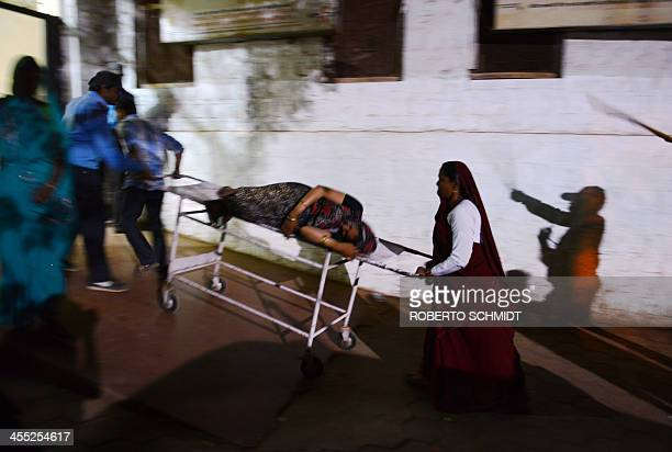 IndiahealthchildrenFEATURE by Trudy HARRIS In this photograph taken on November 6 a pregnant women in the latter stages of pregnancy is wheeled in a...