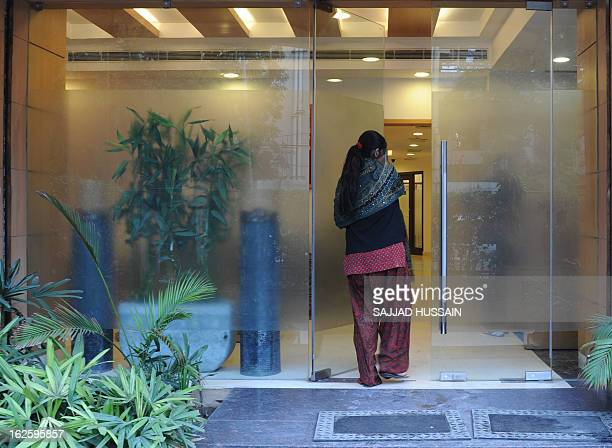 IndiahealthfertilityFEATURE by Beatrice Le Bohec In this photograph taken on February 5 2013 an Indian surrogate mother enters the Surrogacy Centre...