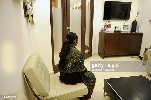 IndiahealthfertilityFEATURE by Beatrice Le Bohec In this photograph taken on February 5 2013 an Indian surrogate mother sits at the Surrogacy Centre...