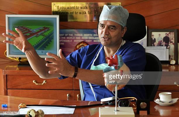 IndiahealthhospitalFEATURE by Adam Plowright Indian philanthropist cardiac surgeon and founder of Narayana HrudayalayaDevi Prasad Shetty gestures...