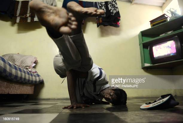 IndialifestylesocietydanceFEATURE by Rachel O'Brien Indian dancer Pankaj Shivpur from the Slumgods a group of breaking or 'bboying' dancers practices...
