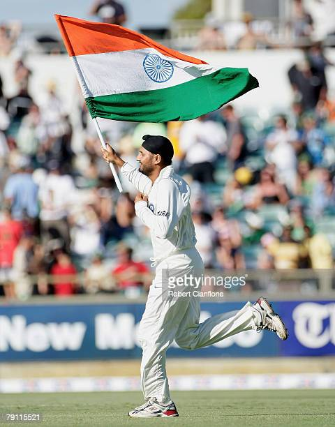 Indian 12th man Harbhajan Singh runs onto the field to celebrate India's 72 run win over Australia after day four of the Third Test match between...