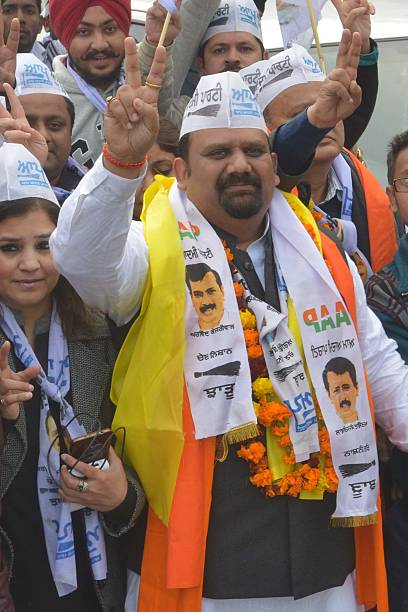 Indian Aam Aadmi Party candidate for the Punjab Legislative Assembly Munish Aggarwal gestures to supporters as arrives to file his nomination papers..