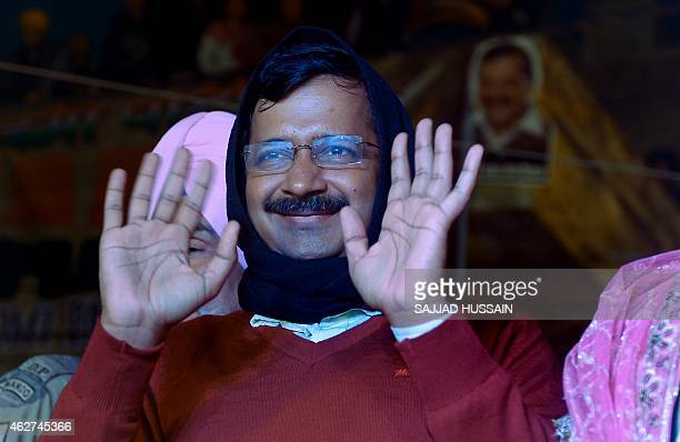 Indian Aam Admi Party party chief, Arvind Kejriwal greets supporters during an election rally in New Delhi on February 4, 2015. Polling in the Delhi...