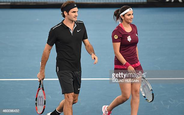 Indian Aces tennis player Sania Mirza and Swiss player Roger Federer talk during their mixed doubles International Premier Tennis League match...