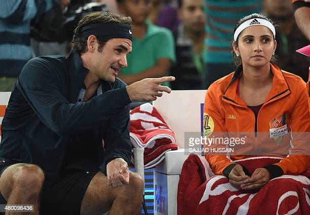 Indian Aces tennis player Sania Mirza and Swiss player Roger Federer talk ahead of their mixed doubles International Premier Tennis League match...