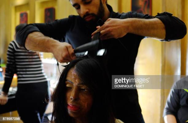 Indian acid attack survivor and model Anupanra has her hair done before a fashion show organised by the 'Make Love Not Scars' NGO in New Delhi on...