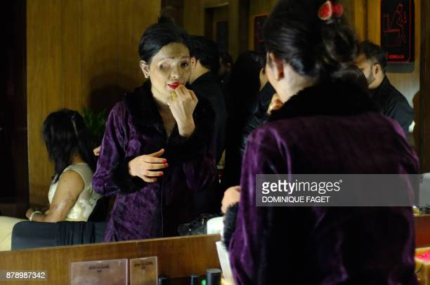 Indian acid attack survivor and model Reshma Qureshi prepares ahead of a fashion show organised by the 'Make Love Not Scars' NGO in New Delhi on...