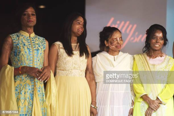 Indian acid attack survivors pose at the end of a fashion show organised by the 'Make Love Not Scars' NGO in New Delhi on November 25 2017 / AFP...