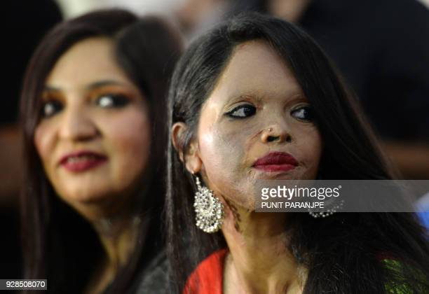 Indian acid attack survivors wait for the start of fashion show as part of a campaign to spread the message 'Stop Acid Sale' in Thane on March 7...