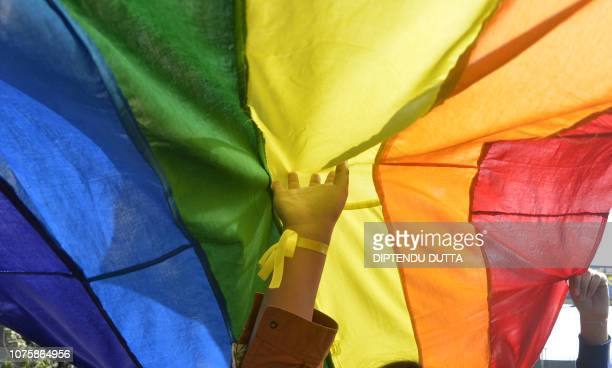 Indian activists and members of the lesbian gay bisexual and transgender community take part in a pride parade in Siliguri on December 30 2018 LGBT...