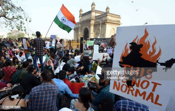 Indian Activists and students shout slogans as they participate in a protest against Sunday's assault by masked assailants at New Delhi's Jawaharlal...