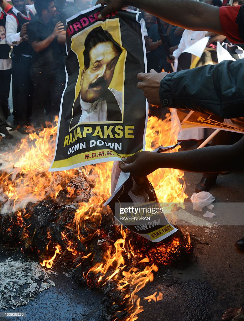 Indian activists from Marumalarchi Dravida Munnetra Kazhagam (MDMK) burn an effigy of Sri Lankan President Mahinda Rajapakse against his visit to India during a protest in New Delhi on February 8, 2013. Tamil groups are demanding that the Sri Lankan president return to his country. Sri Lankan forces crushed Tamil rebels in May 2009 after nearly three decades of brutal fighting with the conflict claiming up to 100,000 lives, according to UN estimates.