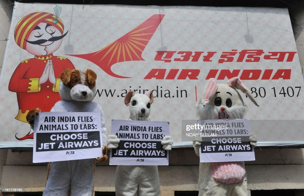 Indian activists from People for the Ethical Treatment of Animals (PETA) dressed dressed as animals holding placard in front of Air India office during a demonstration in Hyderabad on February 15, ...