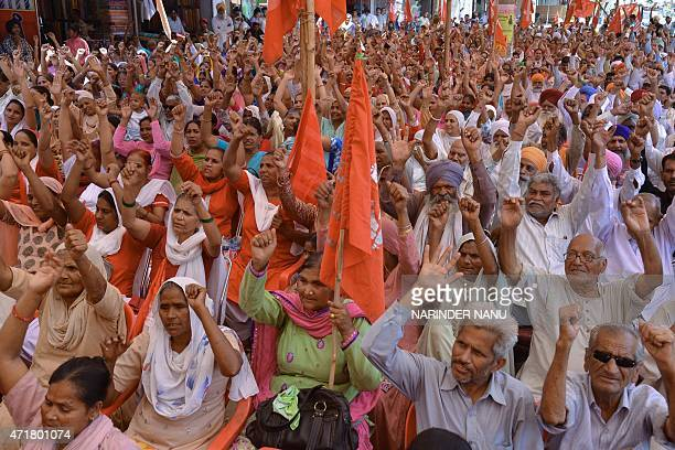 Indian activists from the Communist Party of India along with factory workers shout slogans during a protest rally against alleged antiworkers...