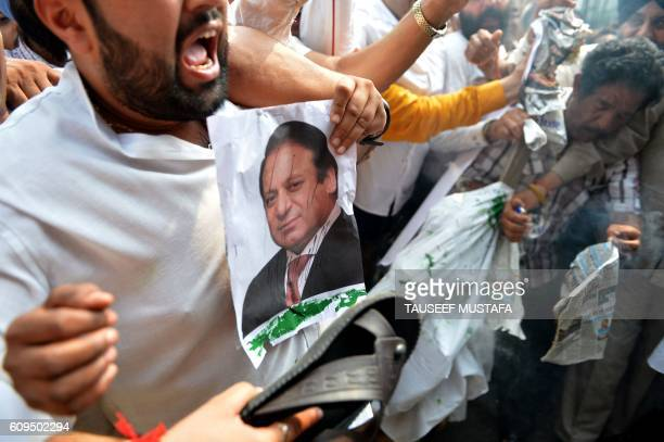 TOPSHOT Indian activists from the Congress Party shout antiPakistan slogans and hold a picture of Pakistan prime minister Nawaz Sharif during a...