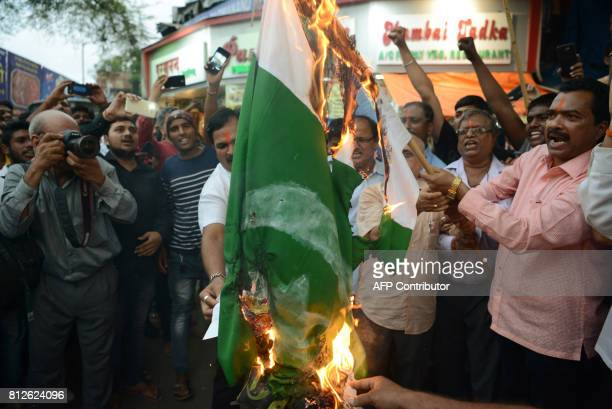 Indian activists from the rightwing Bajrang Dal organisation shout antiPakistan slogans during a protest to condemn an attack on pilgrims during the...