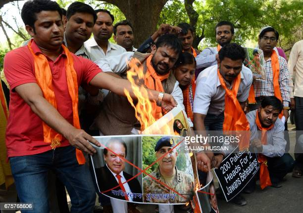 Indian activists from the rightwing organisation Hindu Sena burn posters with images of Pakistani Prime minister Nawaz Sharif and Pakistani army...