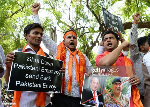 Indian activists from the rightwing organisation Hindu Sena shout slogans as they hold posters with images of Pakistani Prime Minister Nawaz Sharif...
