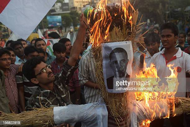 Indian activists from the student and youth wings of Communist Party of India shout antiUS and antiIsraeli slogans as they burn an effigy with an...