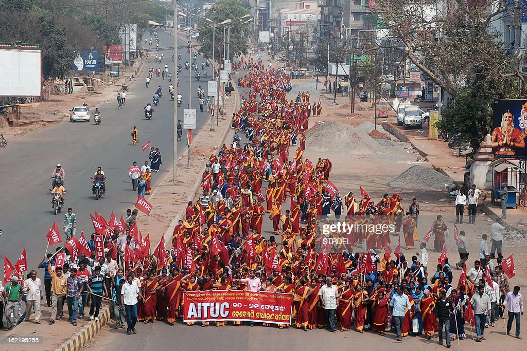 Indian activists from various trade unions participate in a rally during a two-day strike opposing the current UPA government's economic policies in Bhubaneswar on February 20, 2013. Millions of India's workers walked off their jobs on Wednesday in a two-day nationwide strike called by trade unions to protest at the 'anti-labour' policies of the embattled government.