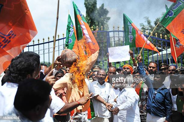 Indian activists of Bharatiya Janata Party burn an effigy of the incumbent UPA government during a protest in Hyderabad on September 24 2012...