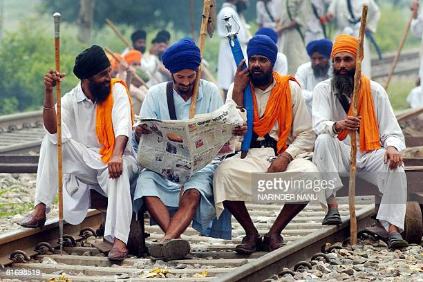 Indian activists of radical Sikh organizations block the railway tracks in protest against the chief of the spiritual organisation Dera Sacha Sauda...