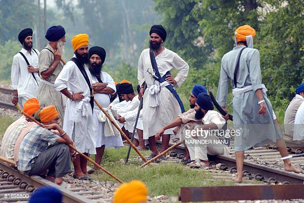 Indian activists of radical Sikh organizations block the railway tracks in protest against the chief of the spiritual organisation Dera Sacha Sauda,...