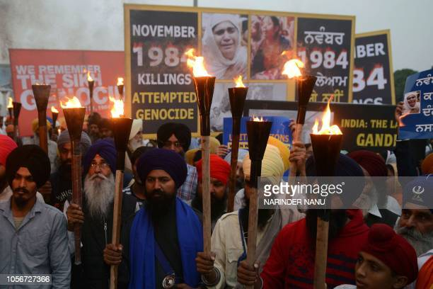 Indian activists of the Dal Khalsa radical Sikh organization march at a protest to commemorate the 1984 antiSikh riots in Amritsar on November 3 2018...