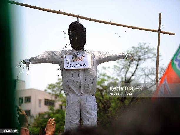 Indian activists of the main opposition Bharatiya Janata Party stone an effigy representing Pakistani Mohammed Ajmal Kasab in Hyderabad on May 7 to...