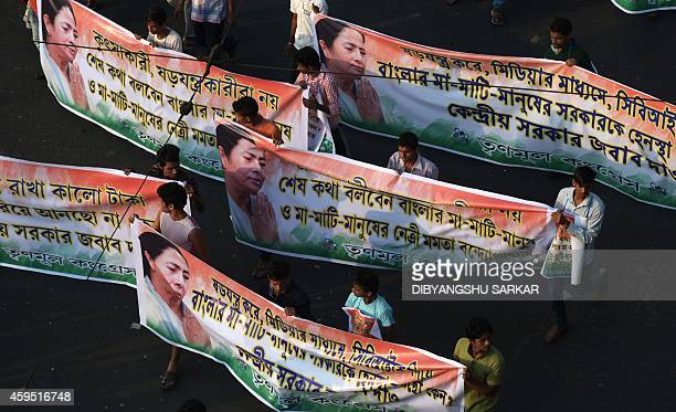 Indian activists of the Trinamool Congress carry banners of party supremo and chief minister of the eastern state of West Bengal Mamata Banerjee as...