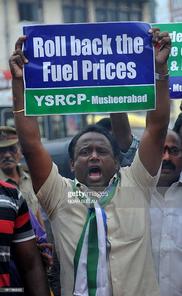 Indian activists of Y S Rajasekhar Reddy Congress Party (YSRCP) shout slogans as they burn an effigy representing the United Progressive Alliance (UPA) government during their protest against the fuel price hike in Hyderabad on February 16, 2013. State-run fuel retailers raised petrol prices by 1.50 INR per litre and diesel by 45 paise per litre, excluding local tax, asof midnight February 15. AFP PHOTO / Noah SEELAM