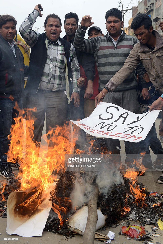 Indian activists of Youth Bhagwan Valmiki Mahasangh Punjab burn an effigy of a terrorist and shout slogans condemning the twin bomb blasts in Hyderabad during a demonstration in Amritsar on February 22, 2013. Indian police revealed Friday they had been warned of a possible attack by Islamist militants in a bustling shopping area of Hyderabad where twin bombings killed at least 14 people and wounded scores.