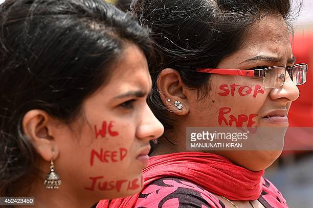Indian activists participate in a rally organised by 'The Red Brigade Bring Bangalore Back' to protest against the recent incidents of sexual abuse...