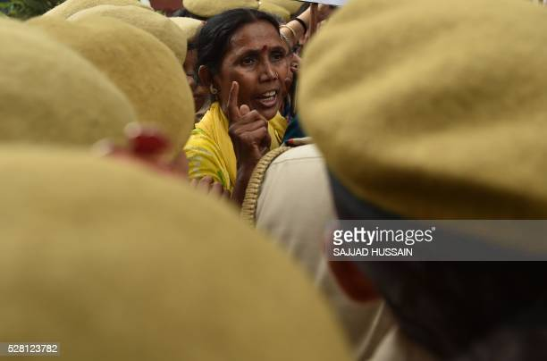 TOPSHOT Indian activists shout slogans as they are confronted by police officials during a protest outside Kerala House in New Delhi on May 4...