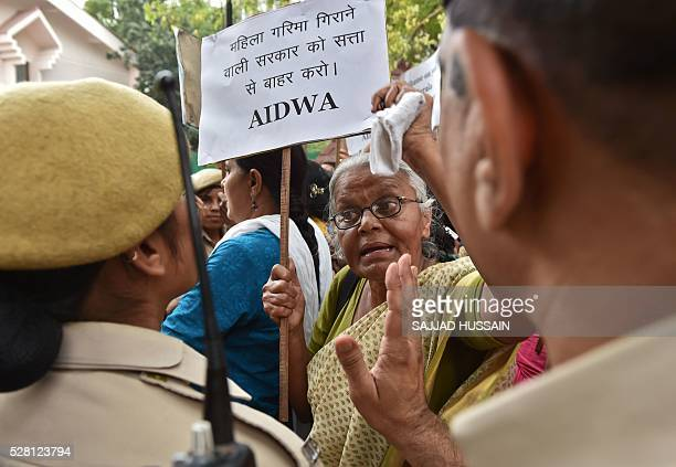 Indian activists shout slogans as they are confronted by police officials during a protest outside Kerala House in New Delhi on May 4 following the...