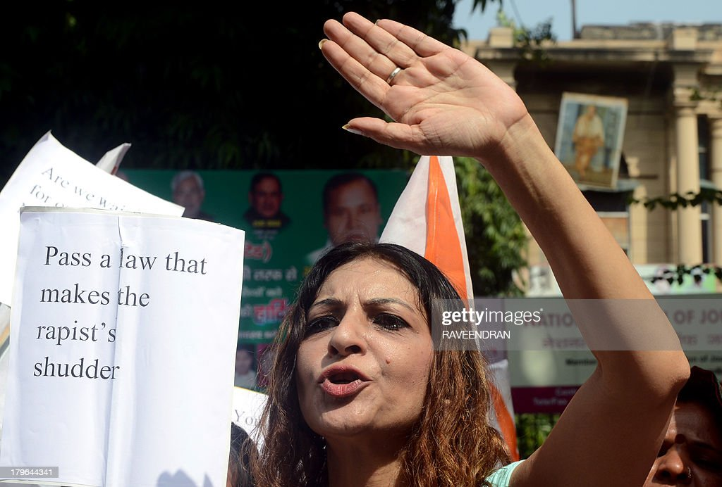 Indian activists shout slogans demanding an amendment of juvenile justice laws during a protest against the sentence of a juvenile convicted in the December 2012 gang-rape of a student, in New Delhi on September 6, 2013. An Indian court found a teenager guilty of taking part in the fatal gang-rape of a student in New Delhi, a crime that sparked revulsion and angry protests in the country. The juveniles' court sentenced the teenager to three years in a correctional facility after handing down the first and long-delayed verdict over the brutal assault on the student on a moving bus last December.
