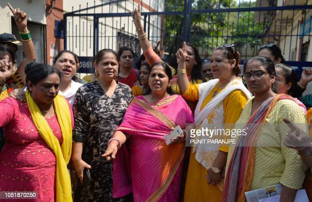 Indian activists shout slogans outside a police station as they demand justice for Bollywood actress Tanushree Dutta who has alleged a sexual...