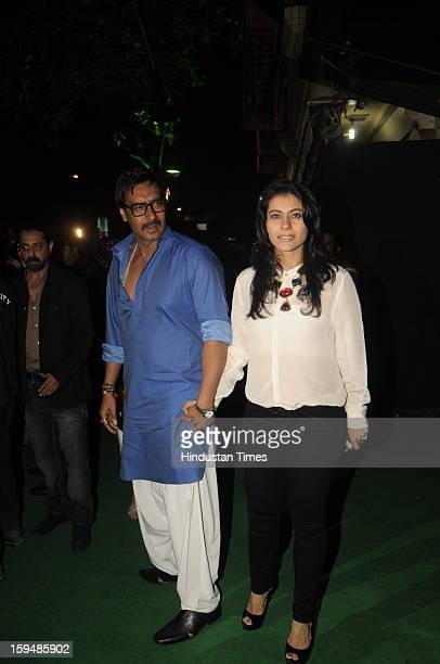 Indian actor Ajay Devgn with his wfe Kajol attending party hosted by Sunil Shetty and Mana Shetty on the launch of their new store R house on January...
