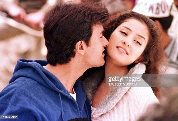 Indian actor Amir Khan kisses actress Monisha Querrilla during the filming of the movie Mann in the city of Gulmarg in India's troubled province of...