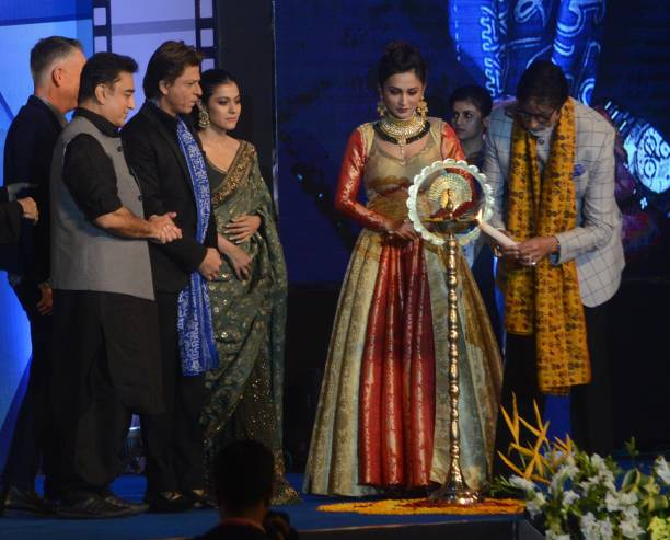 Indian Actor Amitabh Bachchan lights the lamp with Kamal Hasan Shah Rukh Khan Kajol during the inauguration ceremony of 23rd Kolkata International...