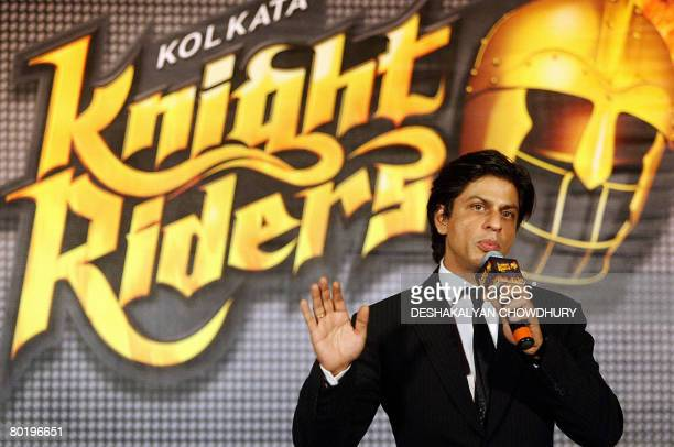 Indian actor and coowner of the 'Kolkata' cricket team Shahrukh Khan gestures as he stands beside the logo of the team 'Kolkata Knight Riders' during...