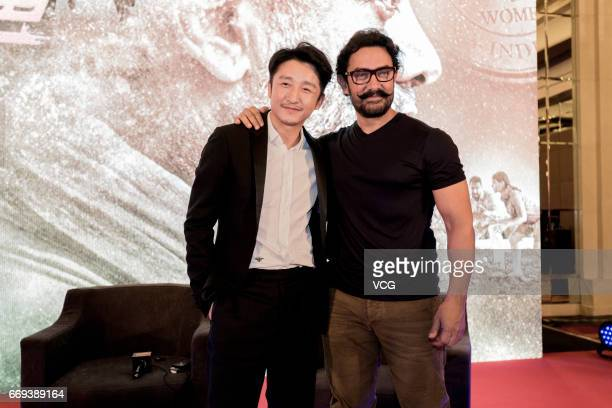 Indian actor and producer Aamir Khan and Chinese boxer Zou Shiming attend the press conference of Bollywood director Nitesh Tiwari's film 'Dangal'...